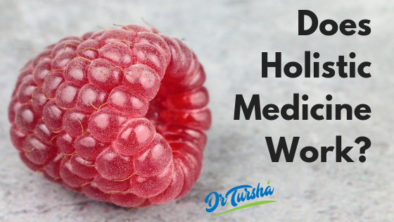 "Image of a Raspberry with the words ""Does Holistic Medicine Work"" next to it."