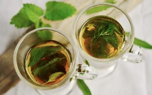 Glass tea cups with tea, decorated with Peppermint leaves