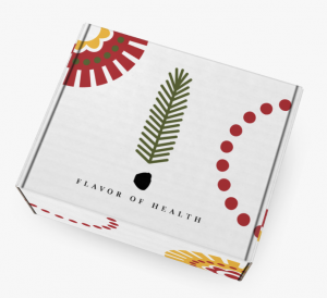 "Shipping Box with the ""Flavor of Health"" logo. A green fern leaf as an exclamation point. Red, yellow, black decorative designs."